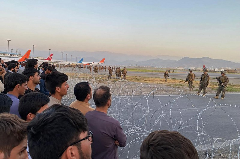Afghans crowd at the Kabul airport.