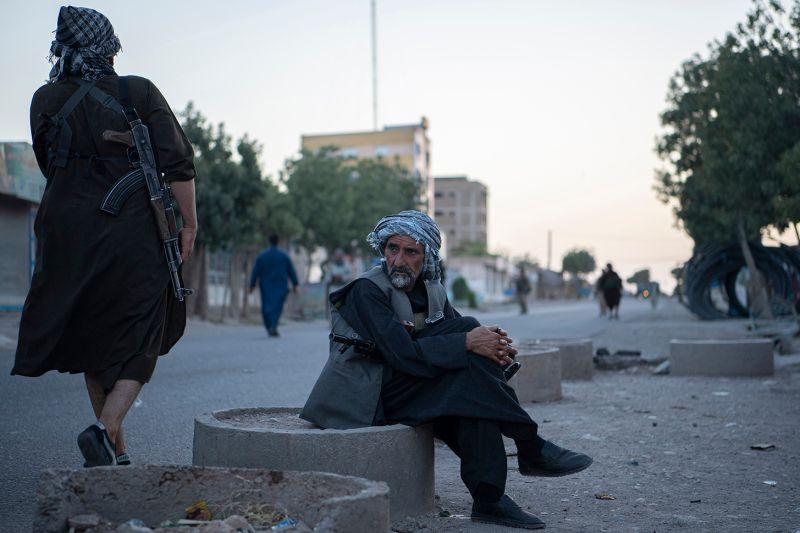 A militia member rests in Afghanistan.