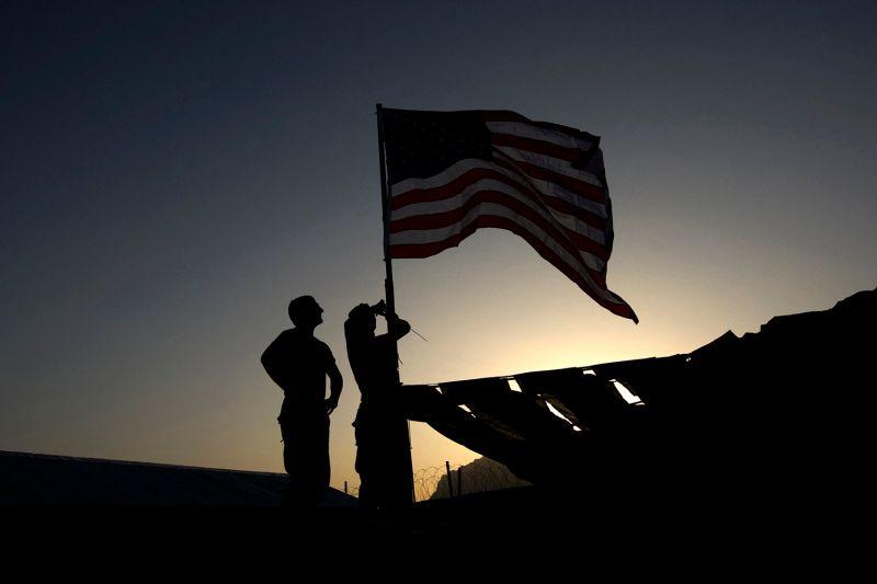 U.S. Marines raise an American flag