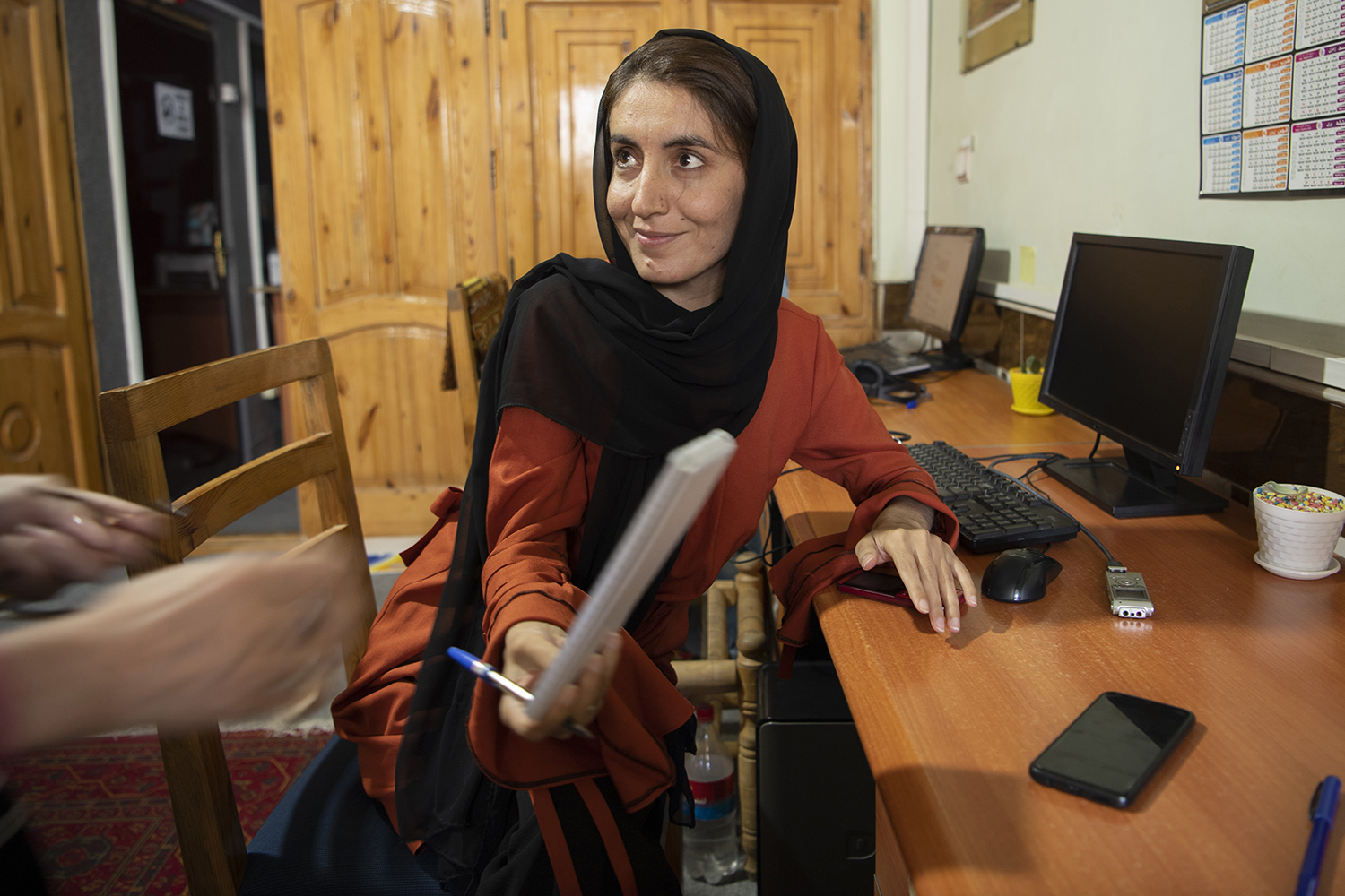 Somaia Valizadeh, an investigative journalist at Khillid Radio, talks during an interview at her office in Herat city on Aug. 3.
