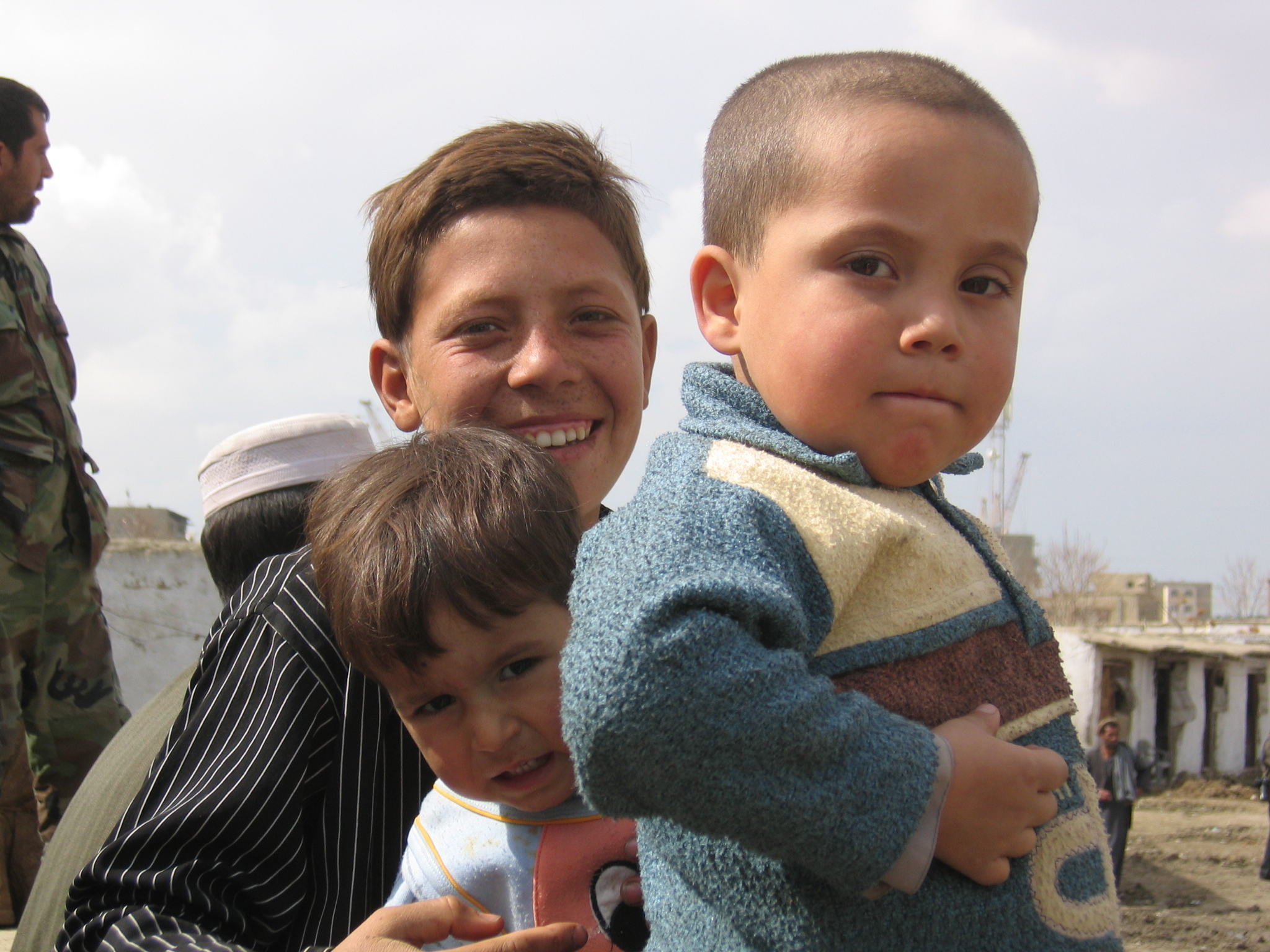 Young children take a break from watching a Buzkashi (the Afghan national sport) match in Kabul