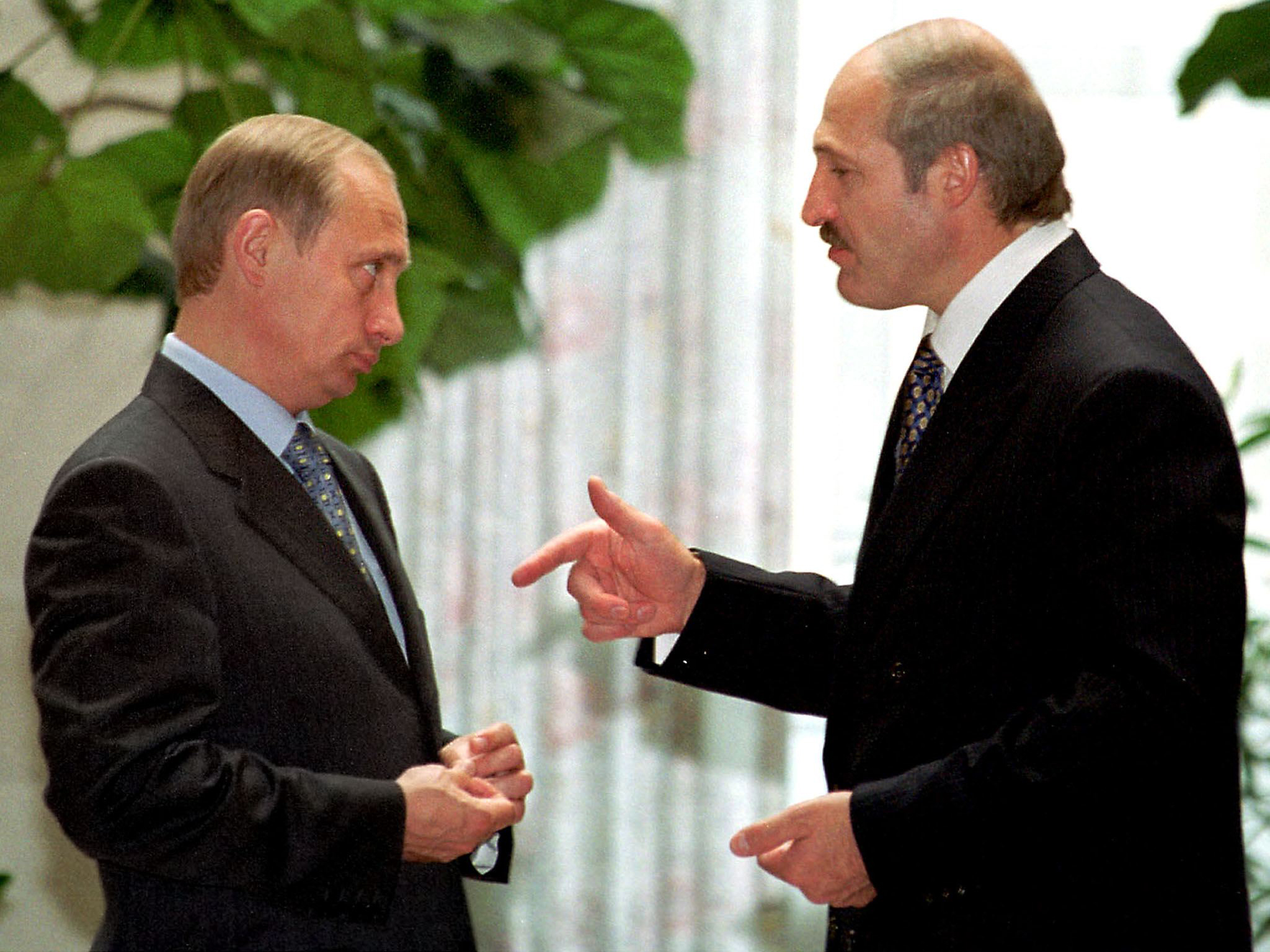 """Lukashenko (right) talks with Russian President Vladimir Putin during their meeting in Moscow's Kremlin on June 27, 2000. <span class=""""attribution"""">STF/AFP via Getty Images</span>"""