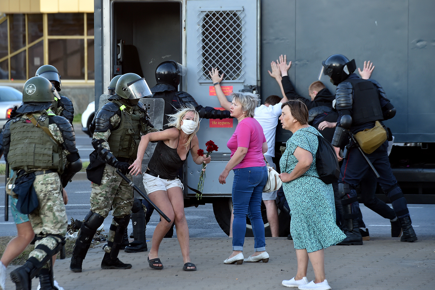 Riot police detain protesters during a rally of opposition supporters, who accuse strongman Aleksandr Lukashenko of falsifying the polls in the 2020 presidential election, in Minsk, Belarus, on Aug. 11, 2020.