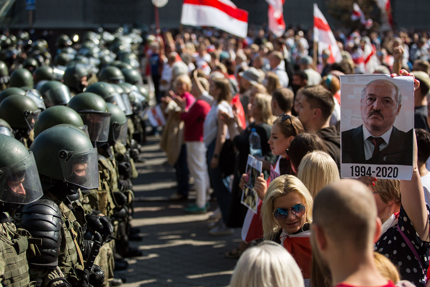 Belarusian service members block a street during an opposition supporters' rally protesting against the presidential election results in Minsk on Aug. 30, 2020.