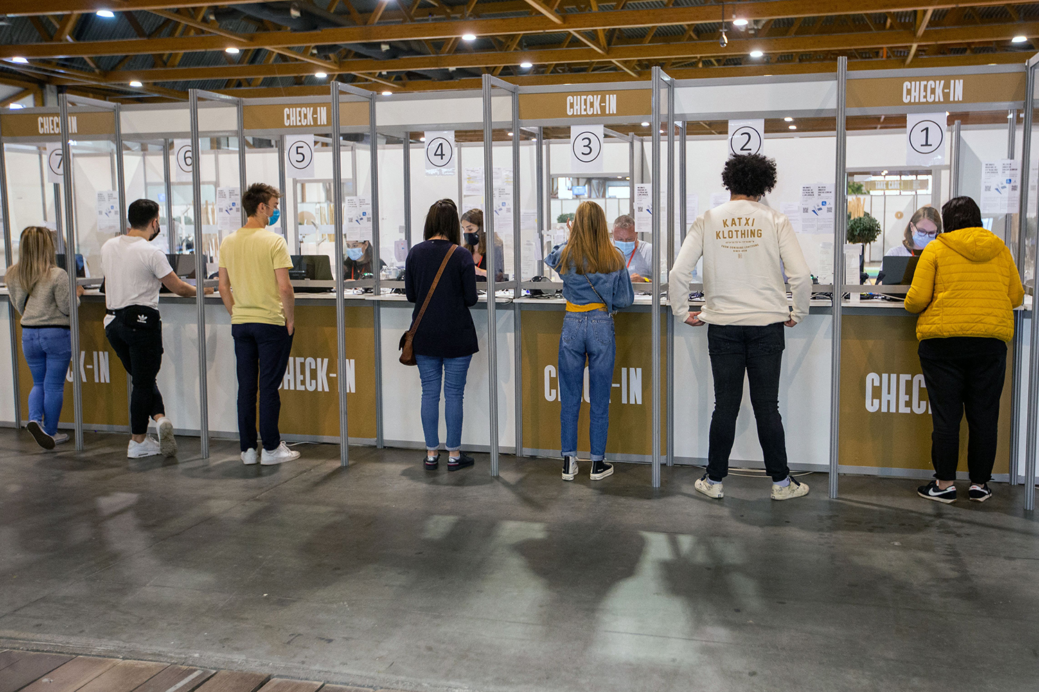 Young people check in at the Brussels Expo vaccination center