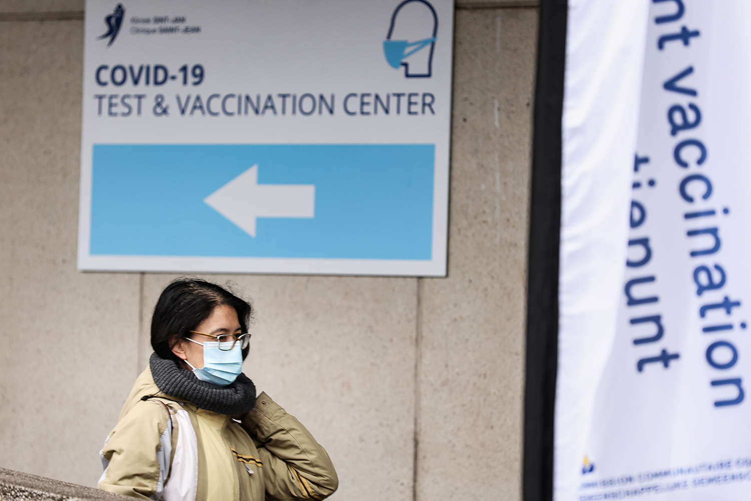A woman leaves Belgium's first COVID-19 vaccination center