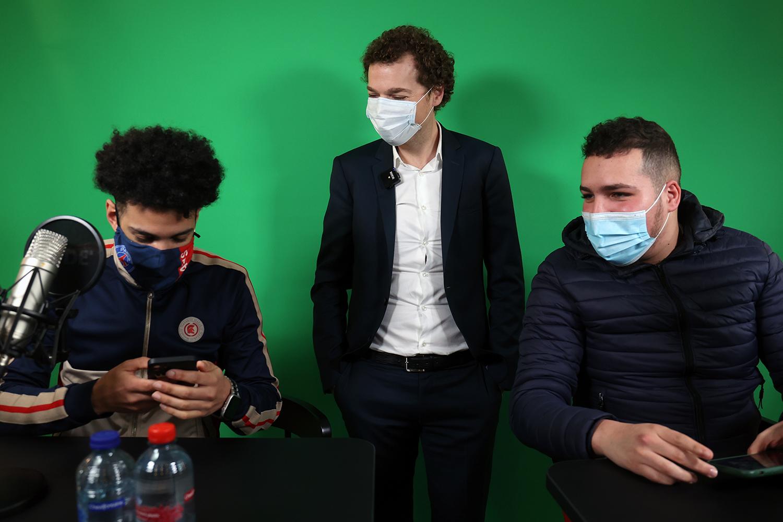 Young men prepare for a COVID youth anti-virus campaign.