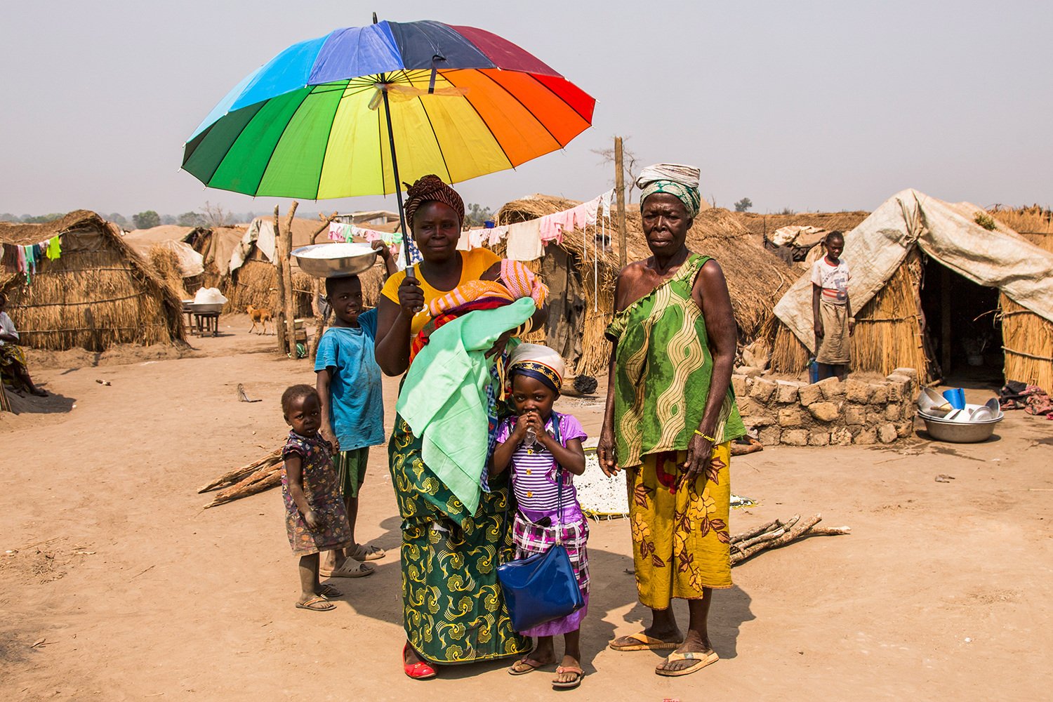 A family shelters from the midday sun