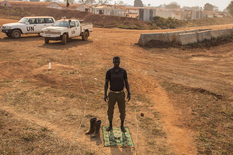 A peacekeeper prays