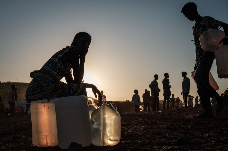 An Ethiopian women sits at a refugee camp in eastern Sudan.