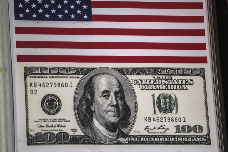 A U.S. national flag and a $100 banknote sticker in Istanbul