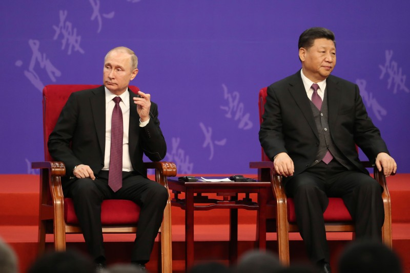 The Russian and Chinese presidents attend a ceremony.