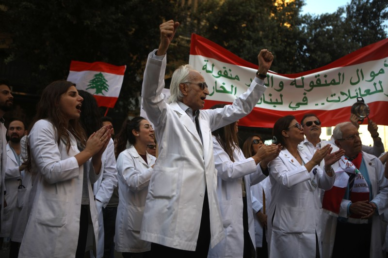 Lebanese doctors chant slogans as they take part in ongoing anti-government demonstrations in central Beirut on Nov. 12, 2019.