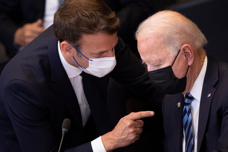 France's President Emmanuel Macron talks to U.S. President Joe Biden before a meeting of the North Atlantic Council at the North Atlantic Treaty Organization (NATO) headquarters in Brussels on June 14, 2021.