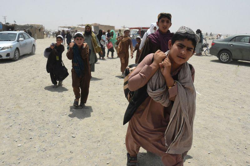 People walk toward a border crossing point in Pakistan.