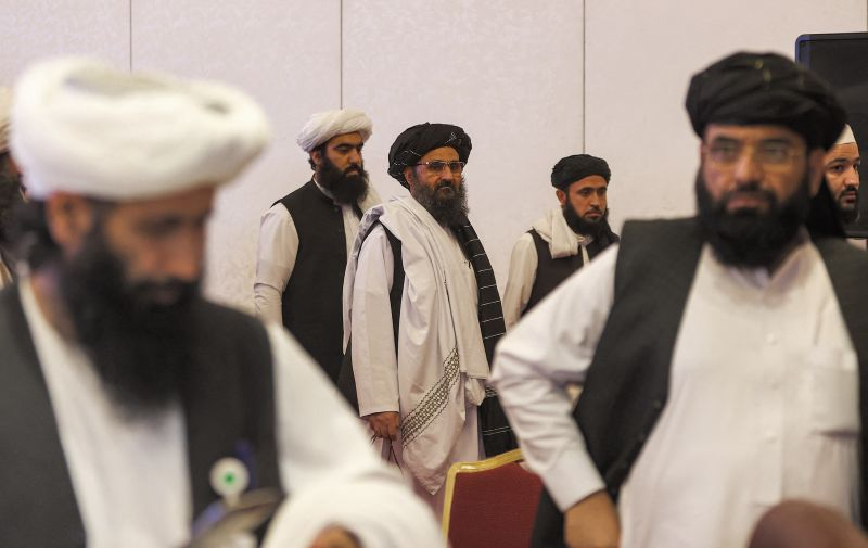 The leader of the Taliban negotiating team Mullah Abdul Ghani Baradar walks after the final declaration of the peace talks between the Afghan government and the Taliban in Qatar's capital Doha on July 18, 2021.