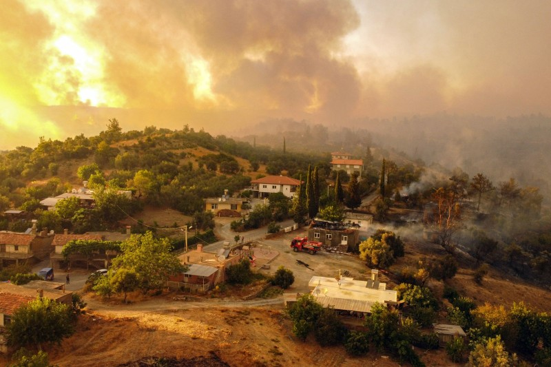 A wildfire which engulfing a Mediterranean resort region on Turkey's southern coast near the town of Manavgat, on July 30, 2021.