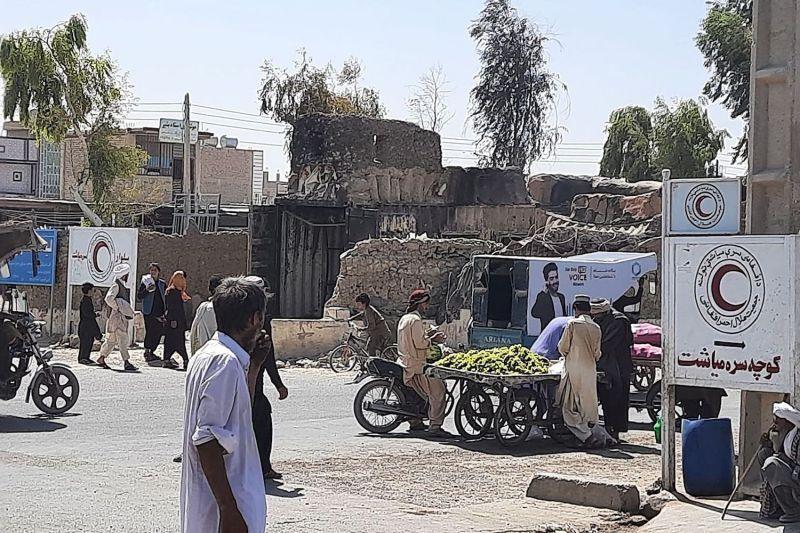 Men walk in Zaranj, Afghanistan.