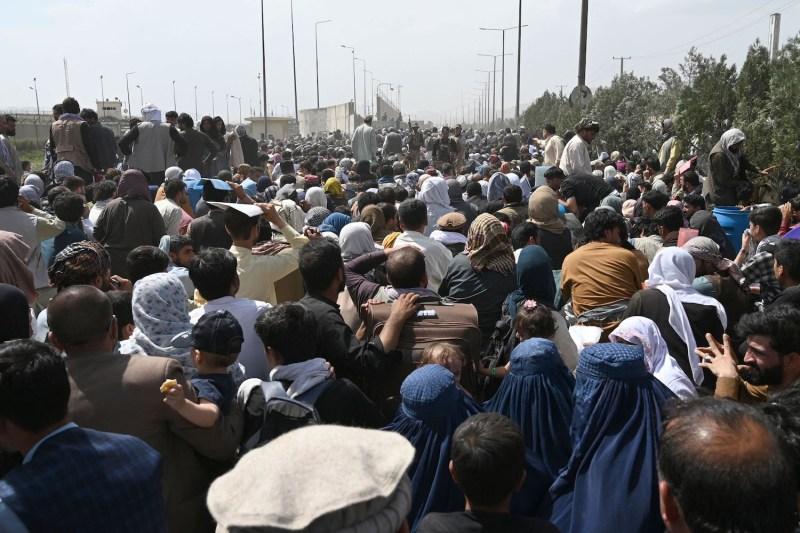 Afghans gather on a roadside in Kabul.