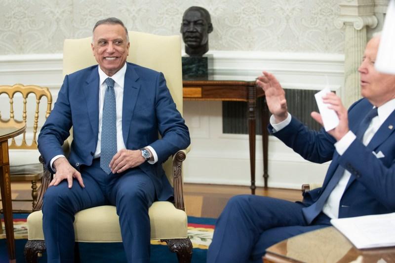 Iraqi Prime Minister Mustafa al-Kadhimi listens as U.S. President Joe Biden speaks.