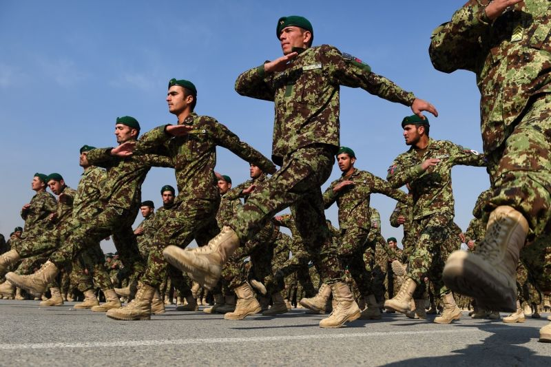 Newly graduated Afghan National Army cadets march during their graduation ceremony at the Kabul Military Training Center in Kabul on Dec. 30, 2014.