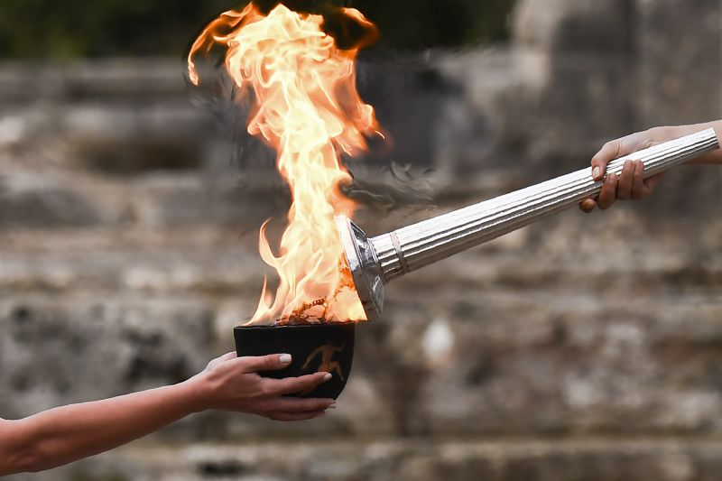 Actress Katerina Lechou lights the Olympic flame at the Temple of Hera in Olympia, the sanctuary where the Olympic Games were born in 776 BC, on October 24, 2017 during the lighting ceremony of the Olympic flame for the 2018 Winter Olympics in Pyeongchang, South Korea.