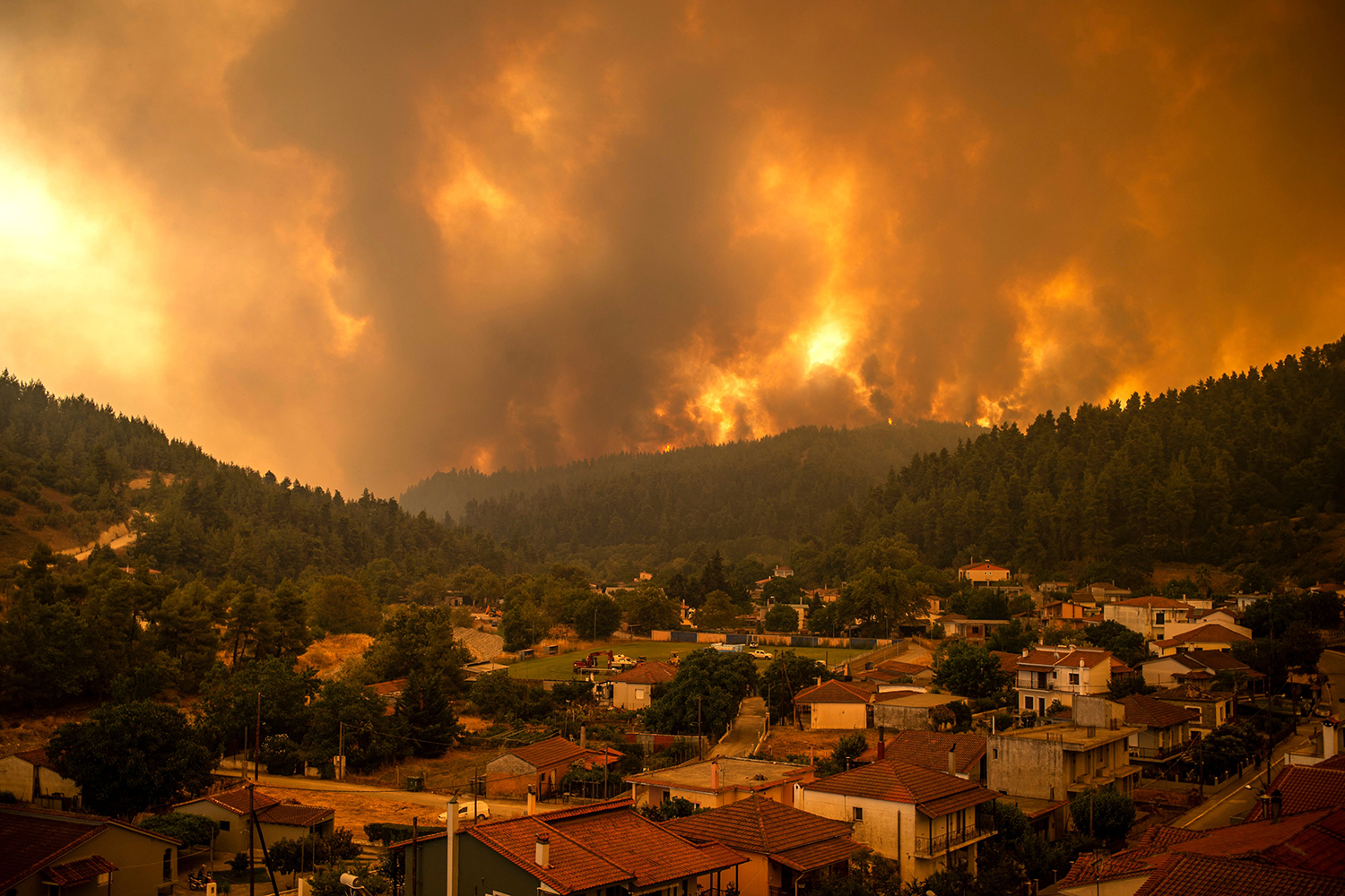 A wildfire moves toward the village of Gouves
