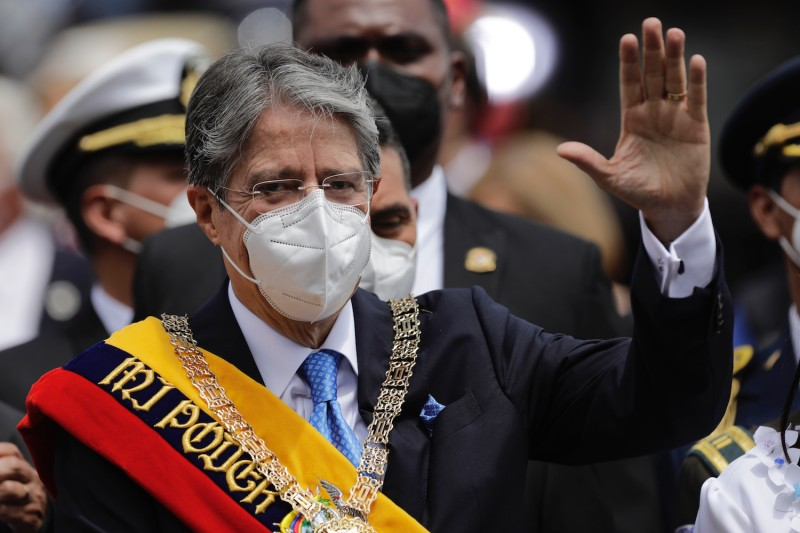 Ecuadorian President Guillermo Lasso greets supporters as he leaves after his inauguration speech at the National Assembly in Quito, Ecuador, on May 24.