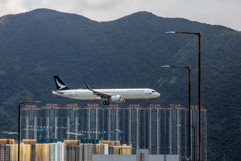 A plane lands in Hong Kong.