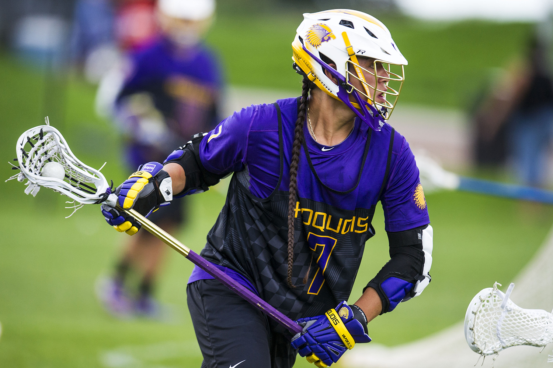 Miles Thompson plays lacrosse