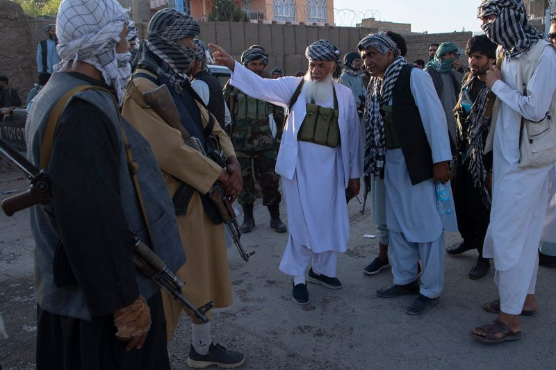 Ismail Khan, the leader of Herat's militia, gives orders to his forces during a clash with the Taliban inside Herat city, Afghanistan, on Aug. 2.