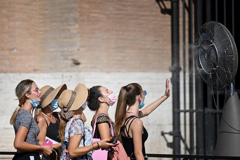 Women get relief from heat with fan