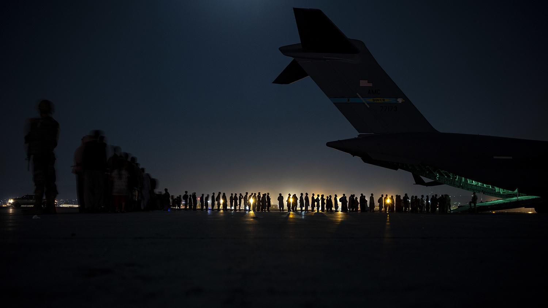 An air crew prepares to load evacuees in Kabul.