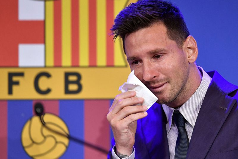 Argentine soccer forward Lionel Messi cries during a press conference at the Camp Nou stadium in Barcelona on Aug. 8.