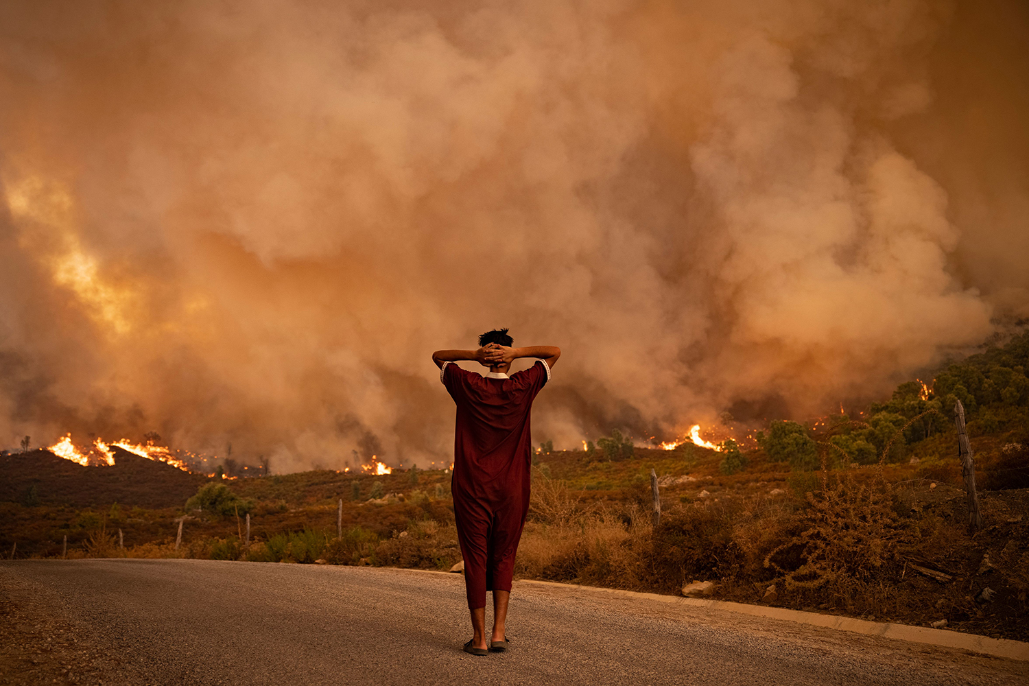 Woman watches fire in Morocco