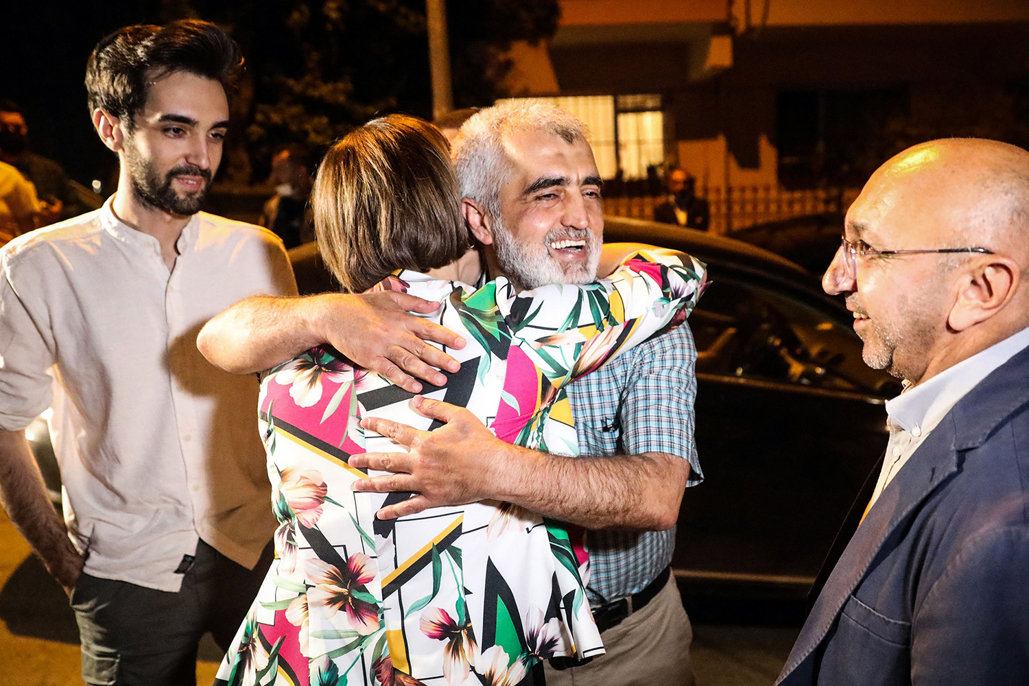 After being released from the Sincan prison, Gergerlioglu hugs a relative in Ankara on July 6.