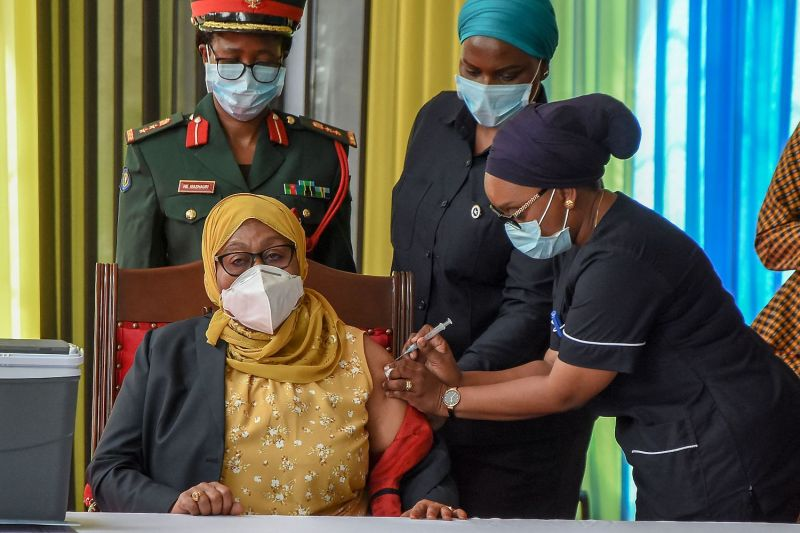 Tanzanian President Samia Suluhu Hassan receives the Johnson & Johnson COVID-19 vaccine from a health worker at the State House in Dar es Salaam on July 28.