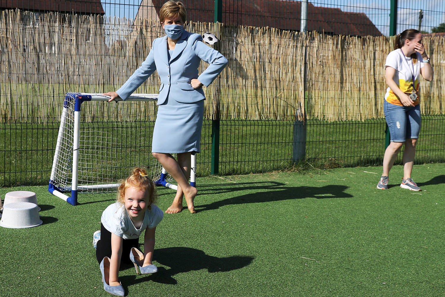 Nicola Sturgeon watches girl play with her shoes