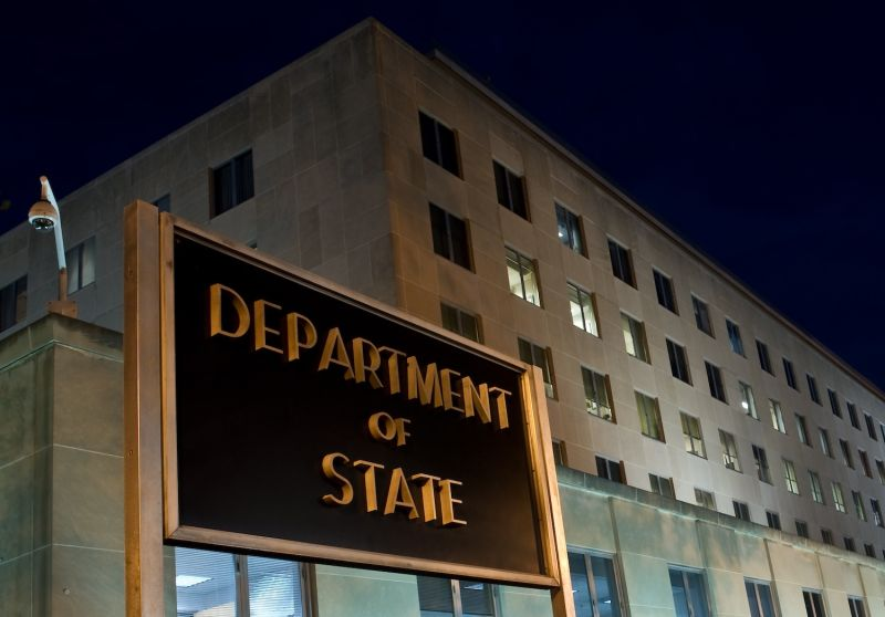 U.S. State Department building is seen at night.