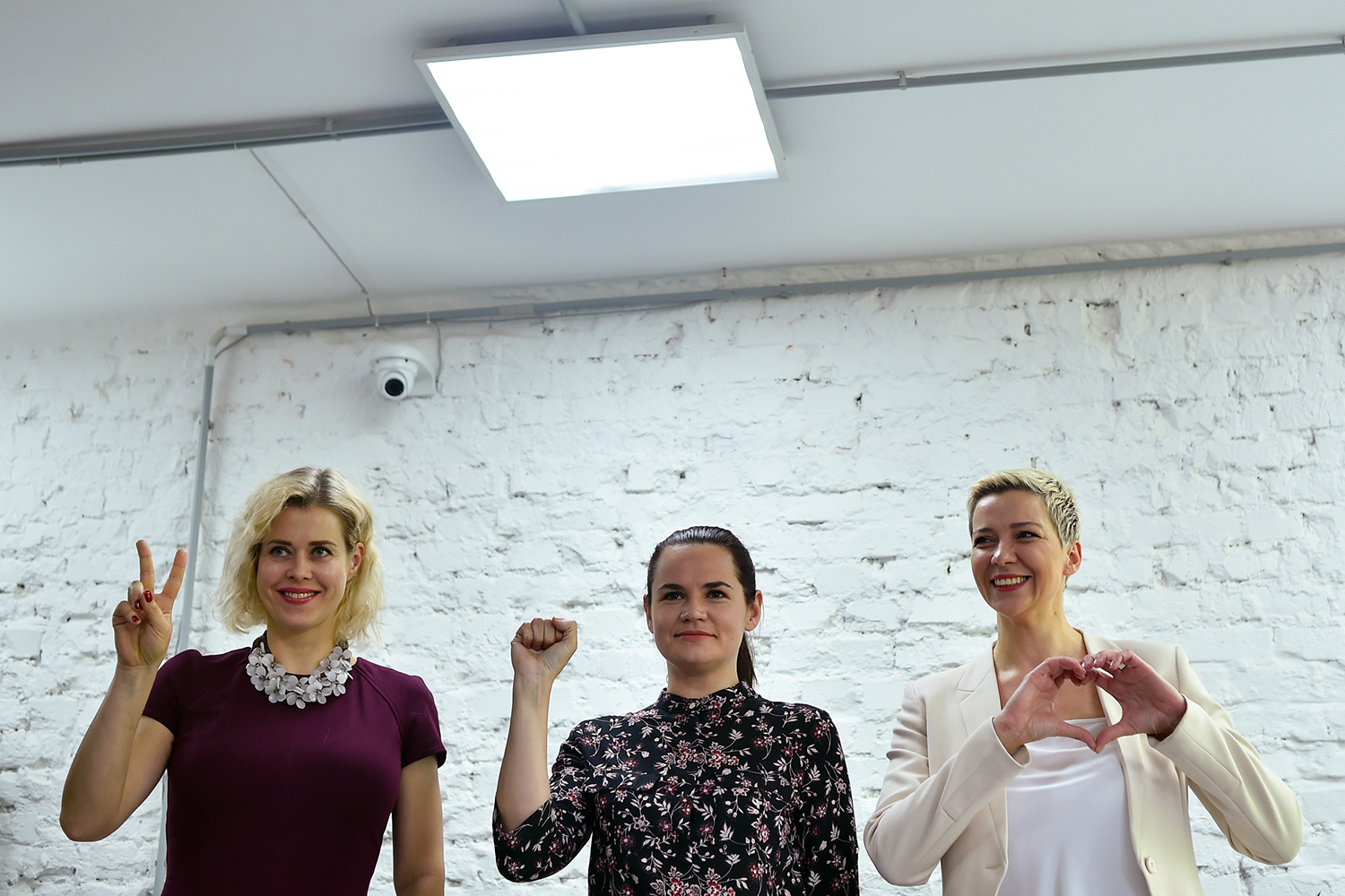 From left: Veronica Tsepkalo, Tsikhanouskaya, and Maria Kalesnikava pose with their signature gestures during a news conference in Minsk on July 17, 2020.