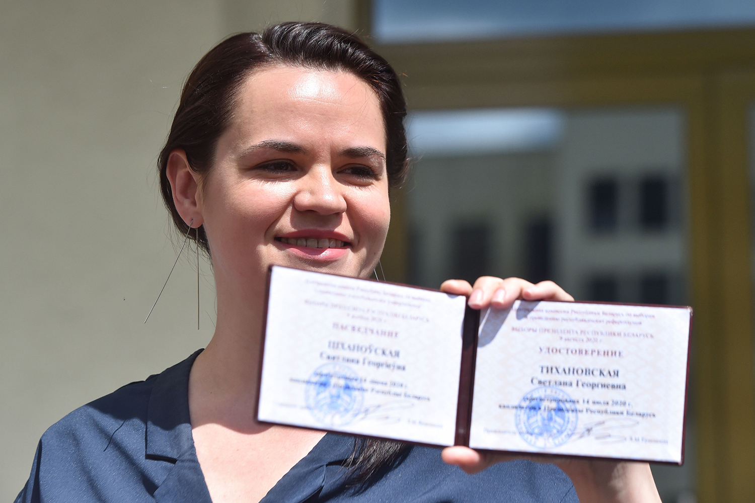 Tsikhanouskaya shows her candidate's certificate after she officially registered for the presidential election in Minsk on July 14, 2020.