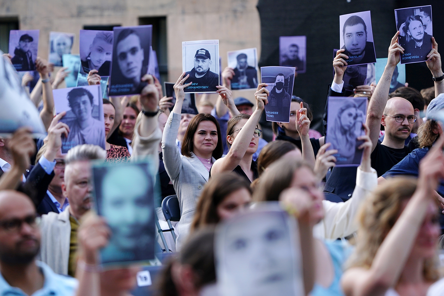 Tsikhanouskaya holds up a photo of her detained husband, Syarhei Tsikhanousky, at the premiere of the documentary Courage during the 71st Berlin International Film Festival on June 11.