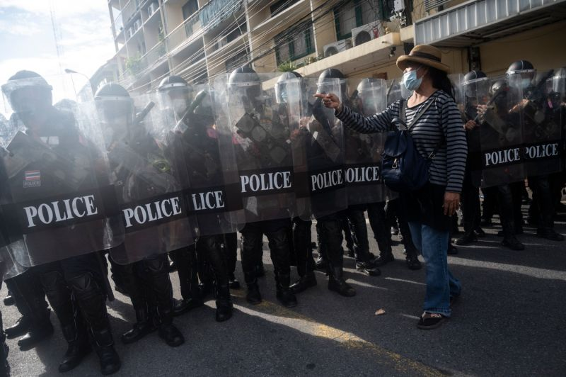 A protester scolds riot police in Thailand.