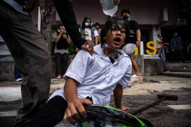 A tear-gassed protester in Thailand