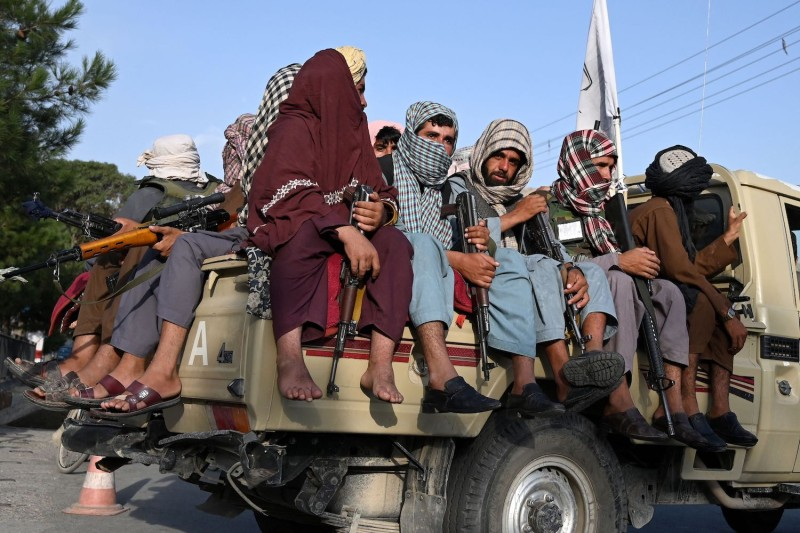 Taliban fighters in a vehicle patrol the streets of Kabul on Aug. 23.