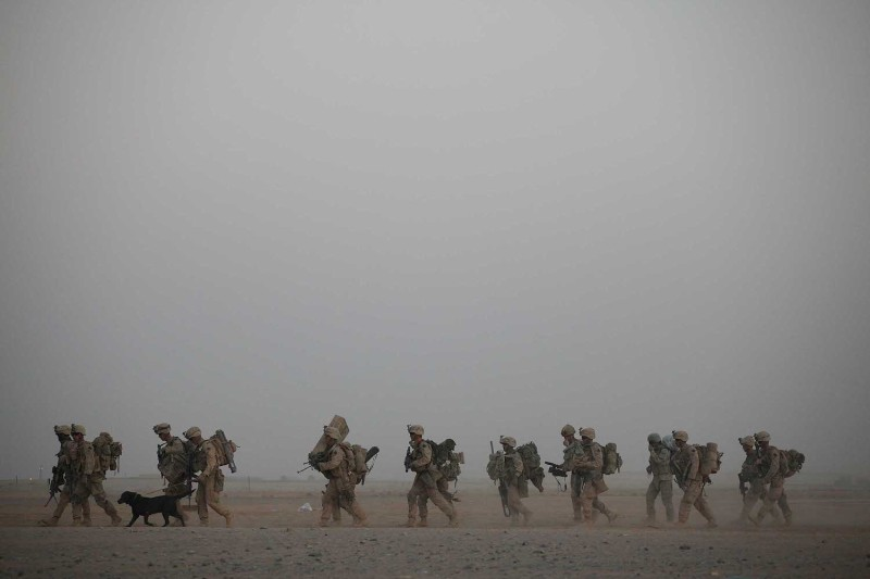 U.S. Marines walk to their helicopter in Afghanistan.
