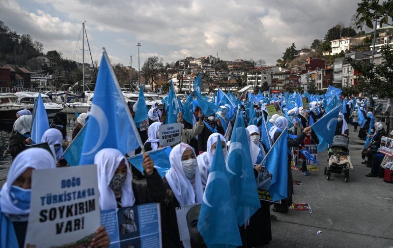 Uyghur women hold East Turkestan flags as they demonstrate near the Chinese Consulate in Istanbul on March 8.