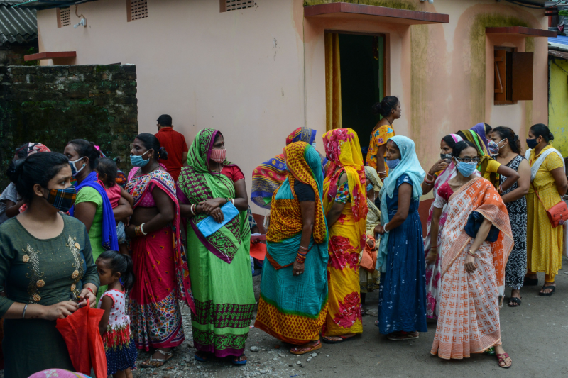 Women line up for a COVID-19 vaccine at a free vaccination camp in Siliguri, India, on Aug. 24.