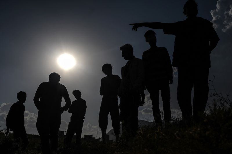 Afghan migrants rest while they wait for transport by smugglers after crossing the Iran-Turkish border on Aug. 15.