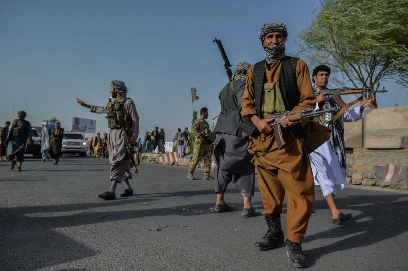 Afghan security personnel and militia fighting against the Taliban stand guard in Enjil, Herat province, Afghanistan, on July 30.